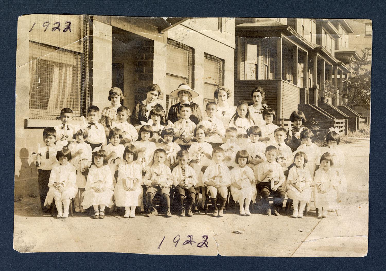 Kindergarten graduates and teachers, 1922: Recto