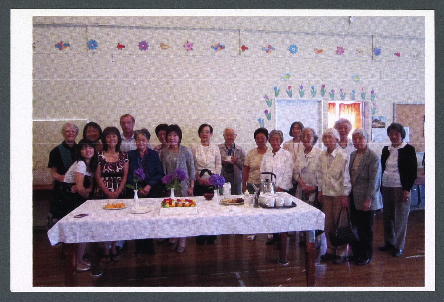 Group of English-speaking congregation members in the church hall