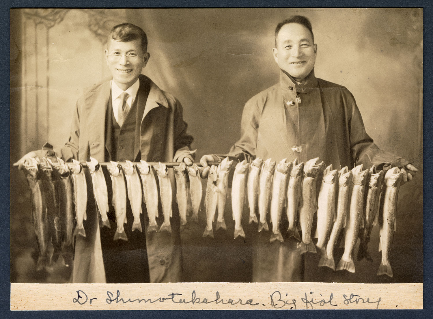 Dr. Shimotakahara and companion displaying fish catch