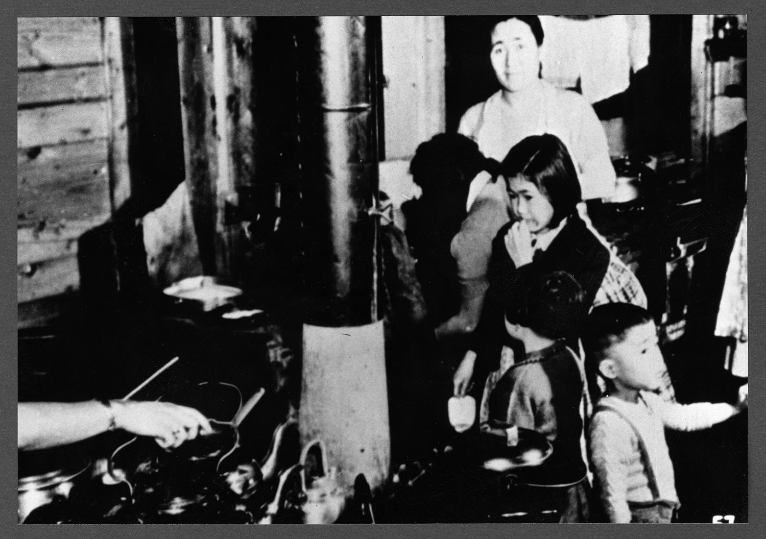 Japanese Canadians in an internment camp: Recto