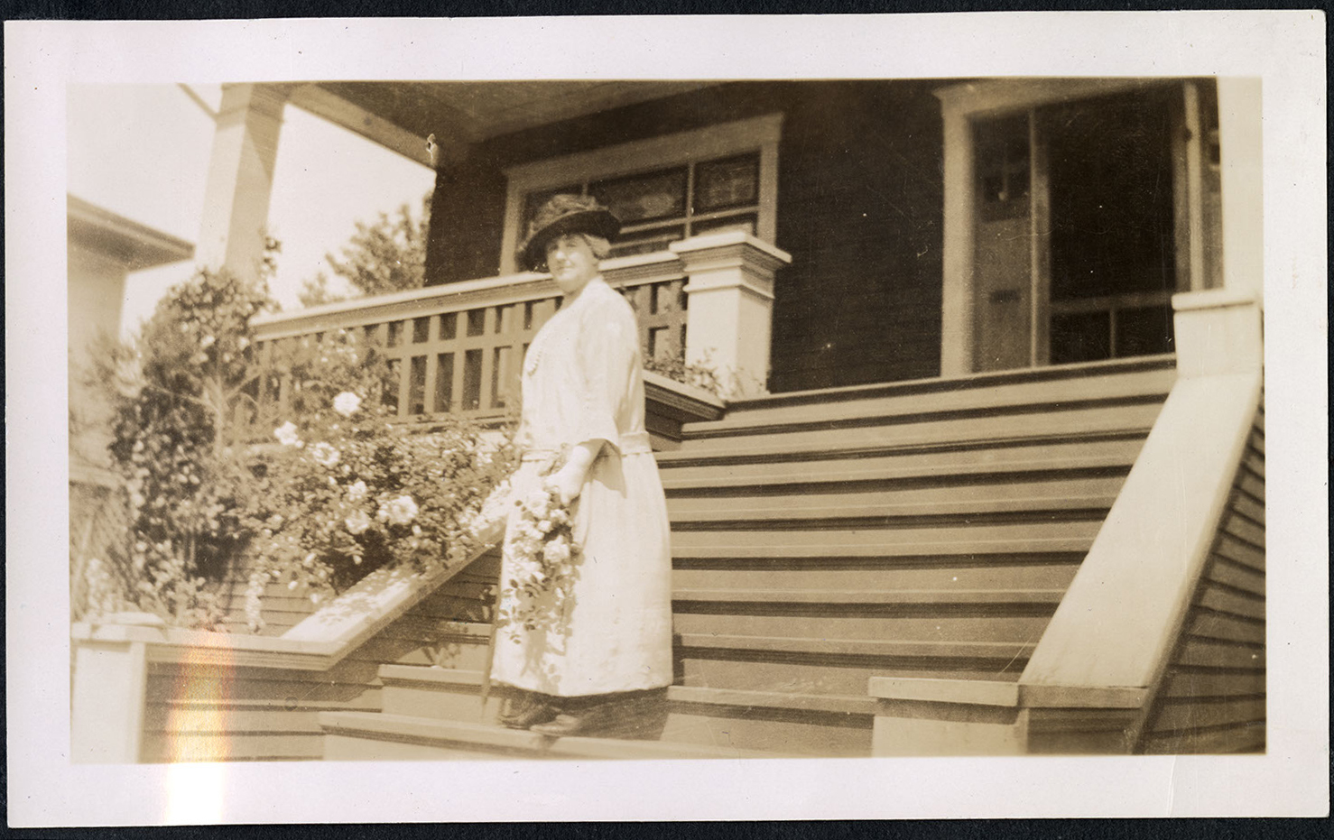 Julia Howie in front of Howie residence