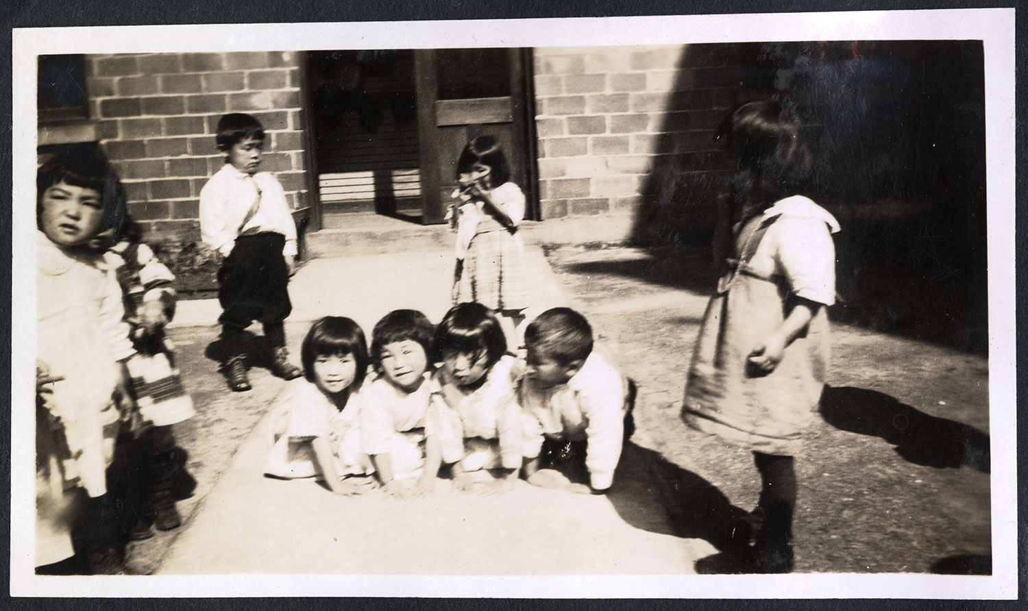 Students playing in front of the Powell Street Church gymnasium