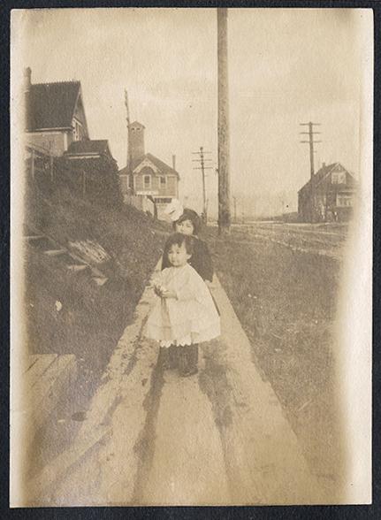 Two little girls on the sidewalk