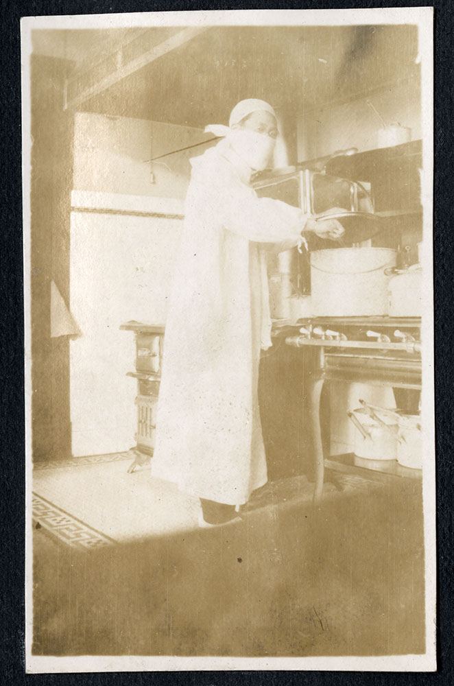 [Dr. Shimotakahara?] in the kitchen of Strathcona School
