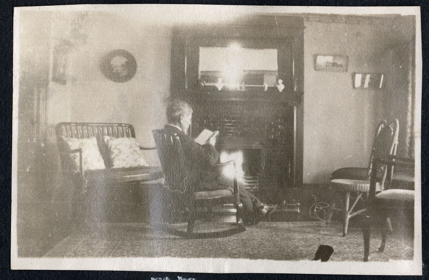 A man sitting in a living room by the fire