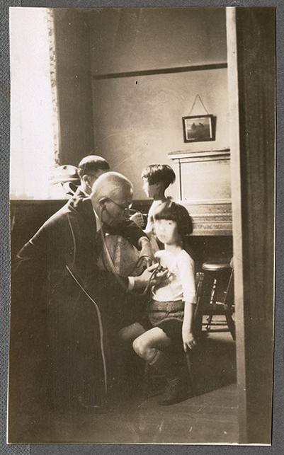 Doctors examining children