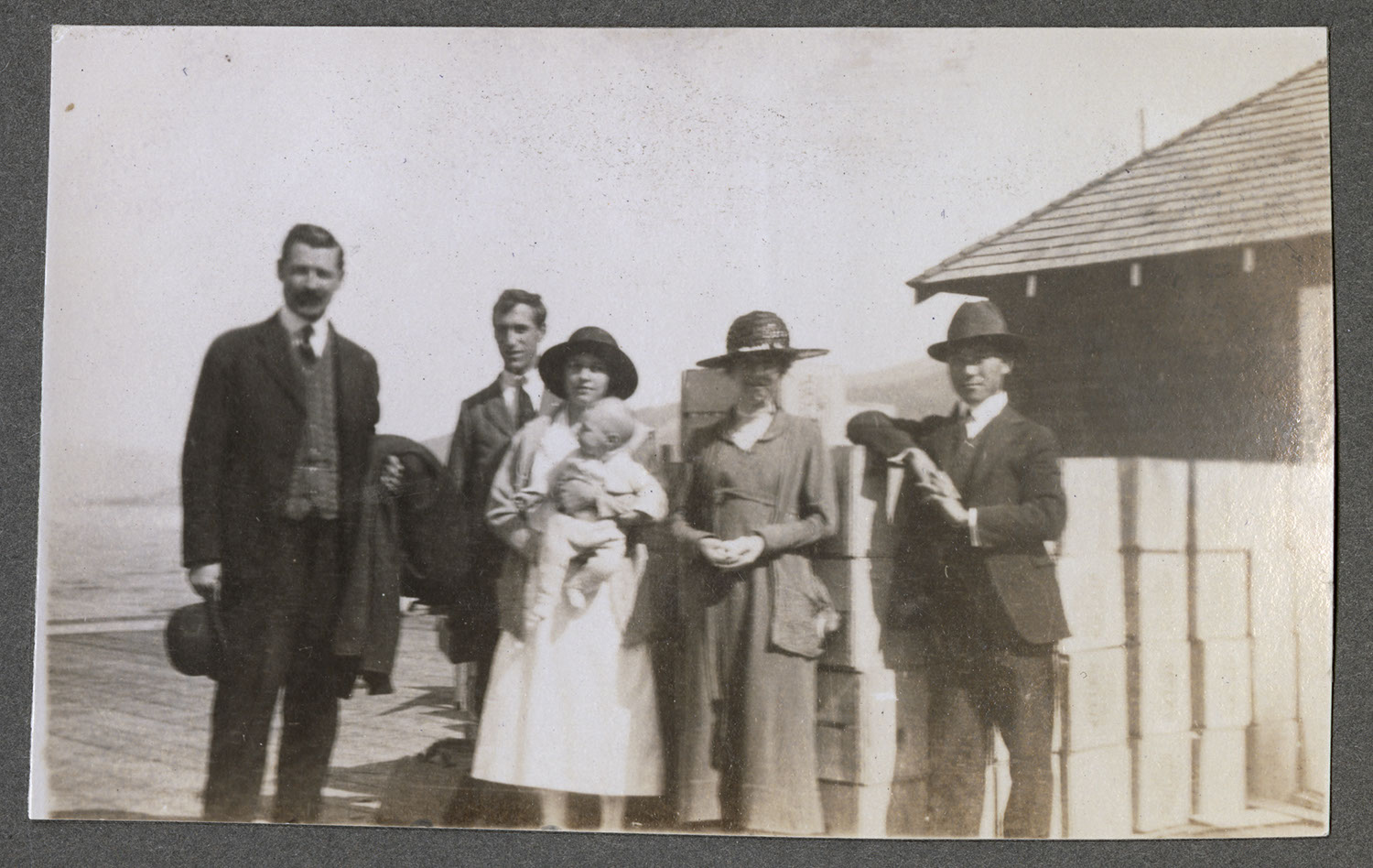 Rev. Osterhout and companions on a dock