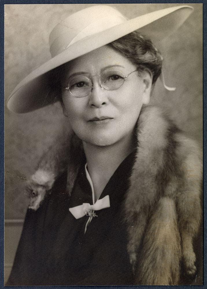 Formal portrait of a woman wearing a mink stole
