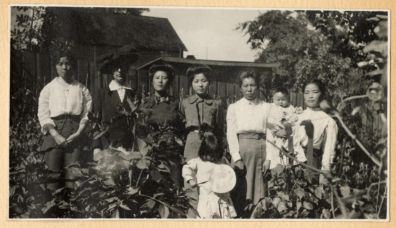 Women and children in the garden
