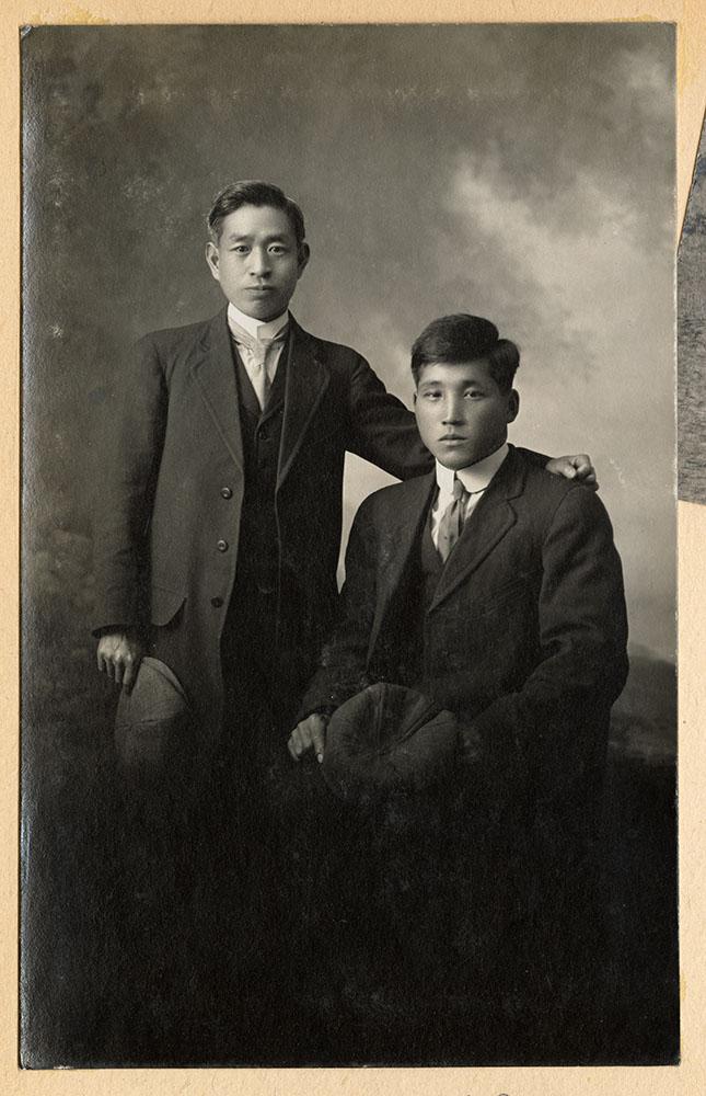 Formal portrait of two men