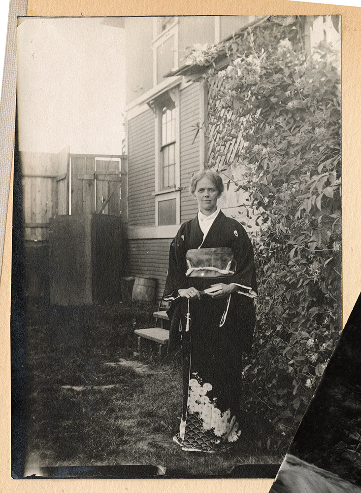 Unidentified woman in kimono in the garden