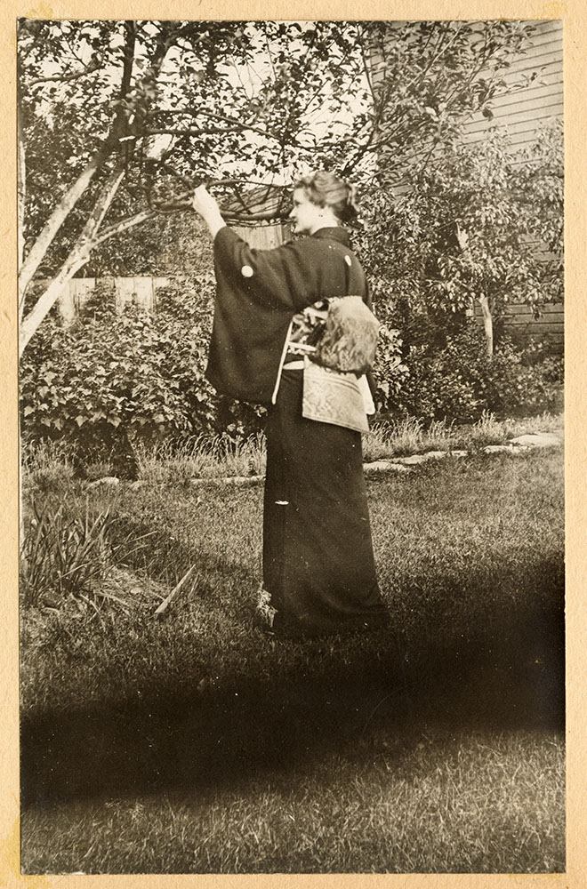 Miss Tompkins in kimono in the garden