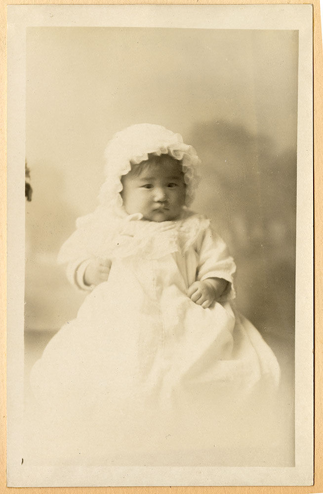 Portrait of an infant in a white gown