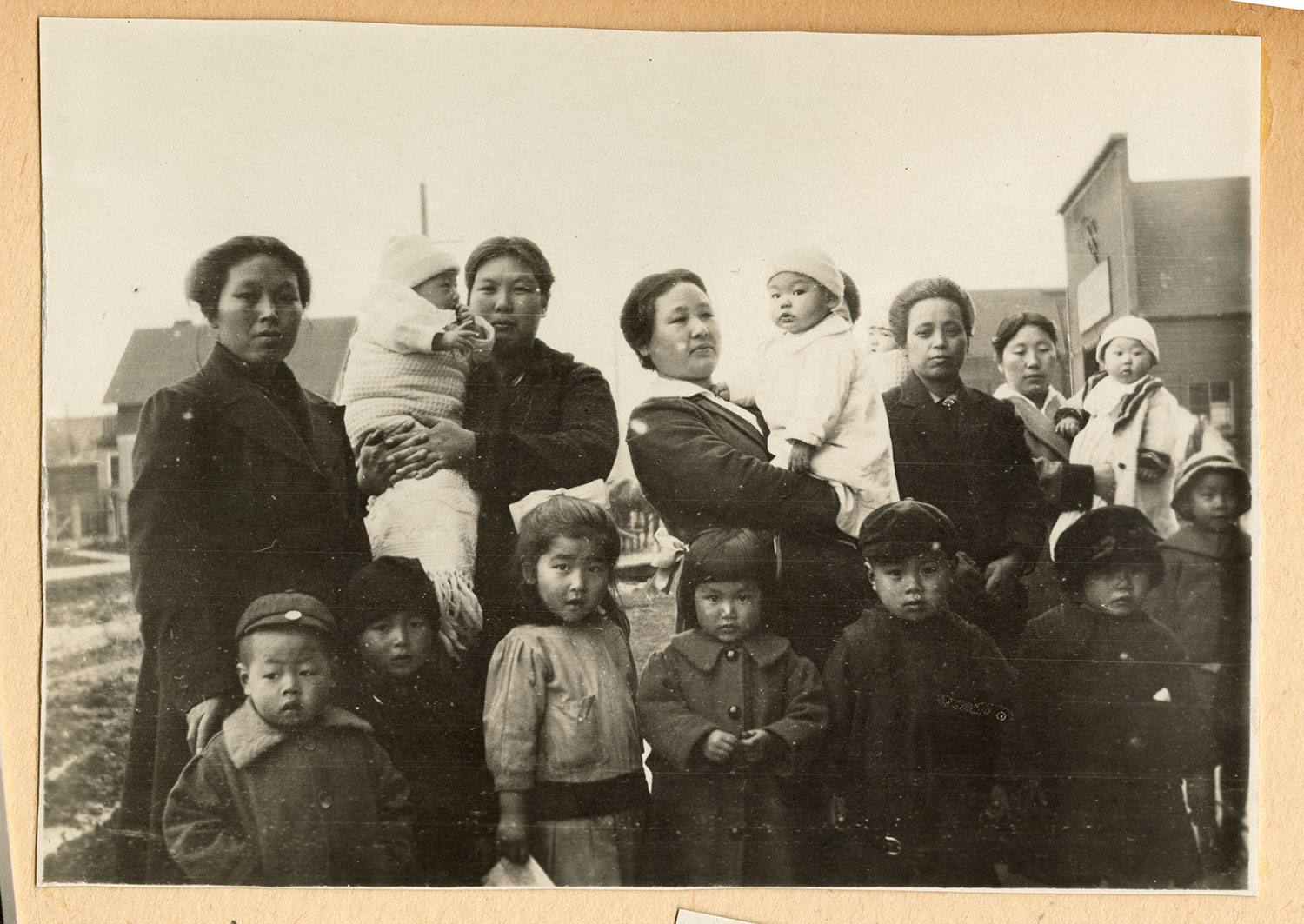 Group of women and children on the roadway