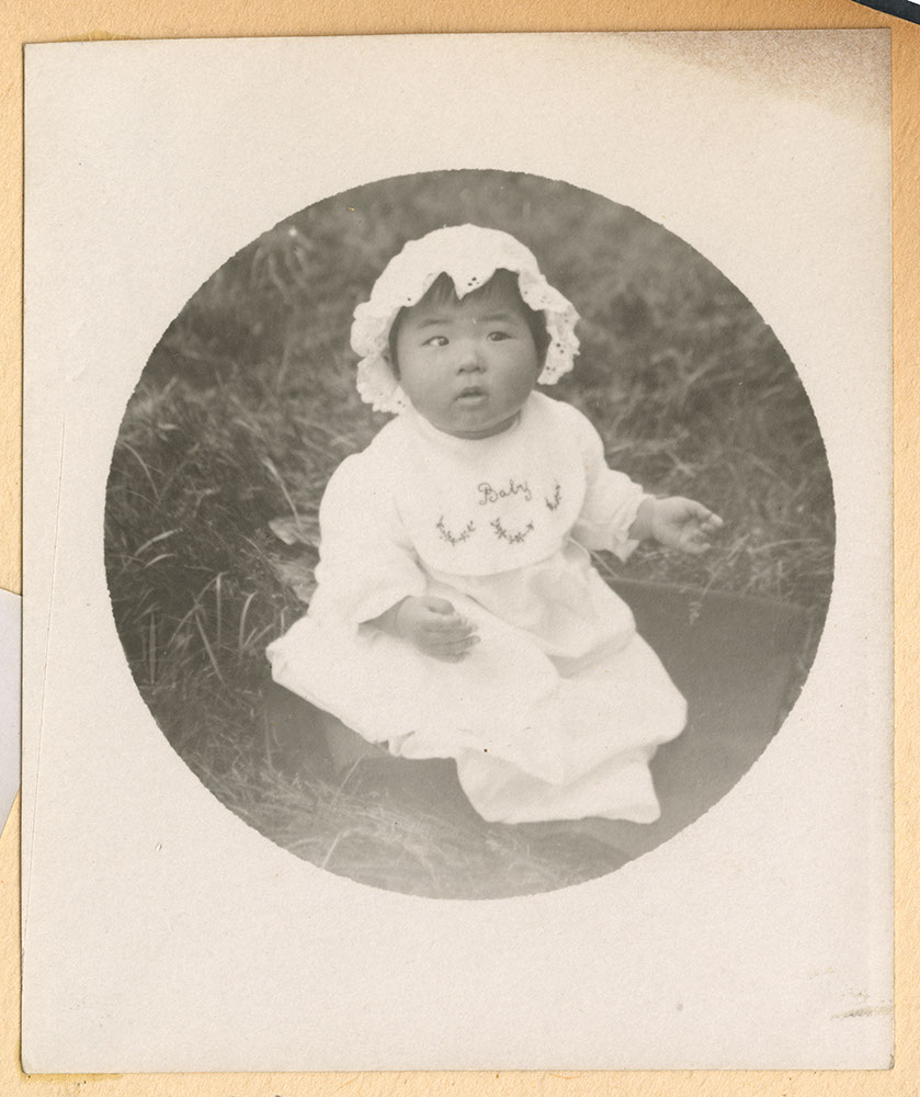 Portrait of infant wearing a bonnet