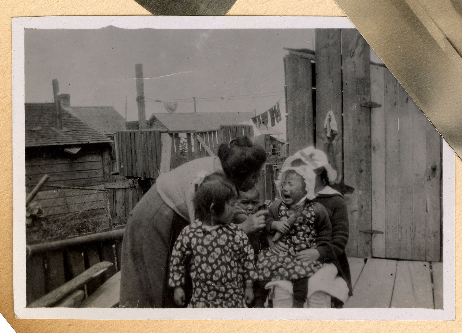 Woman and children by a house