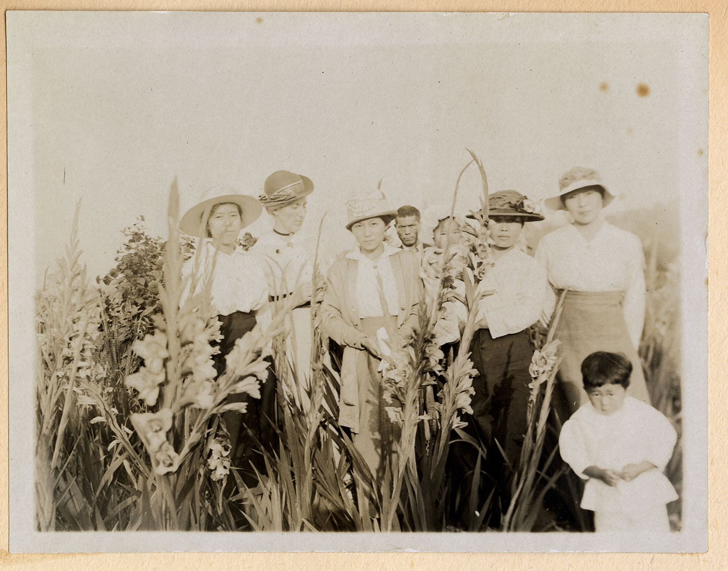 Jessie Howie with a group in the garden