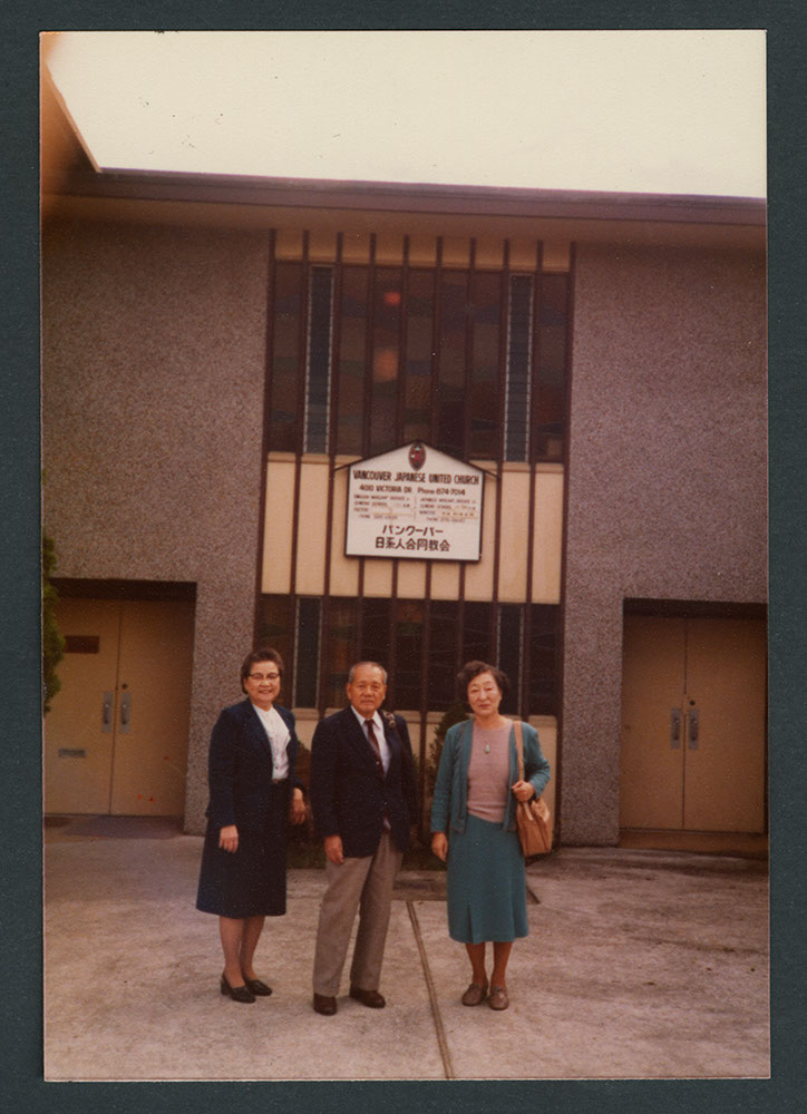 Three members outside the church