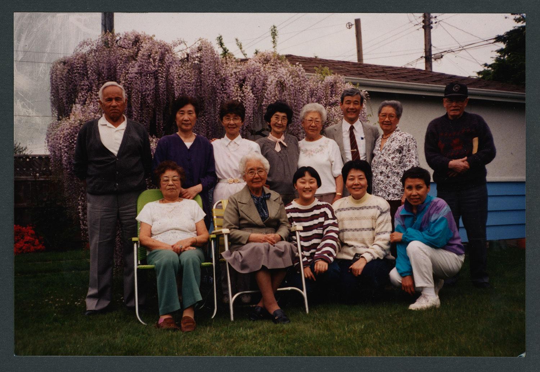 Members in back yard of a home