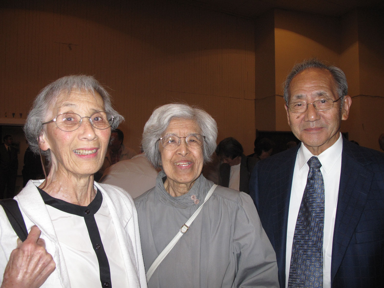 Three members of the English-speaking congregation